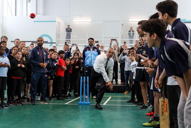 Lord Patel of Bradford bowls at the new Urban Cricket Centre in Leyton
