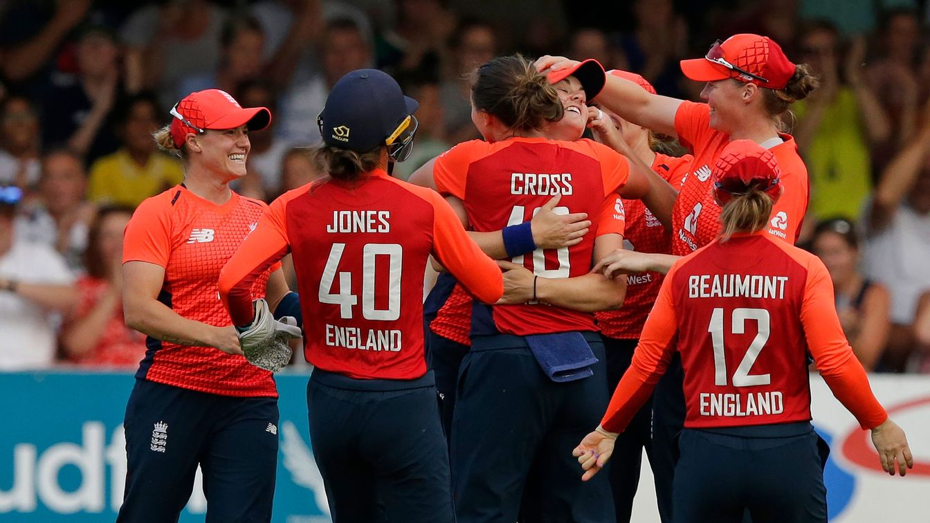 England celebrate taking a wicket in the opening IT20