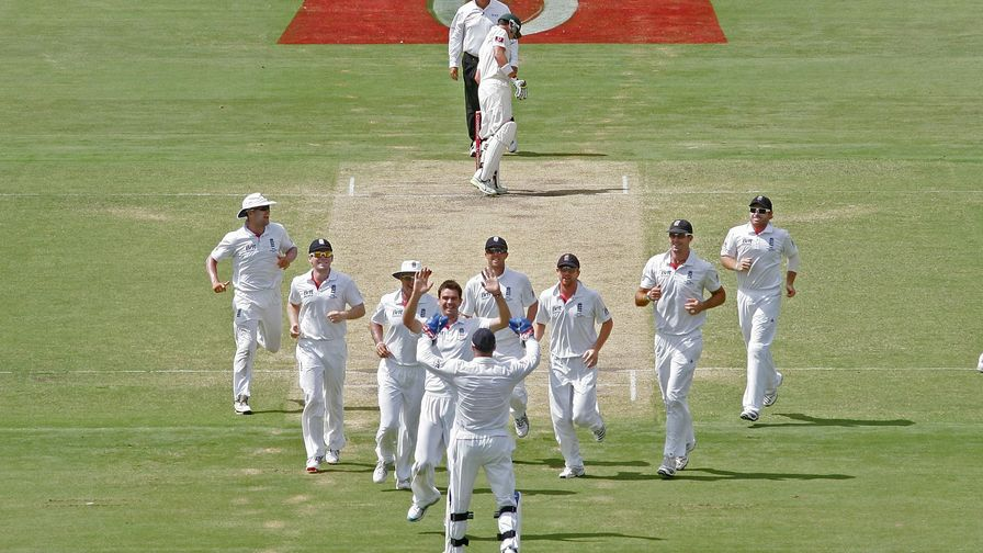 Awesome in Adelaide. James Anderson celebrates with his England teammates on the way to victory.