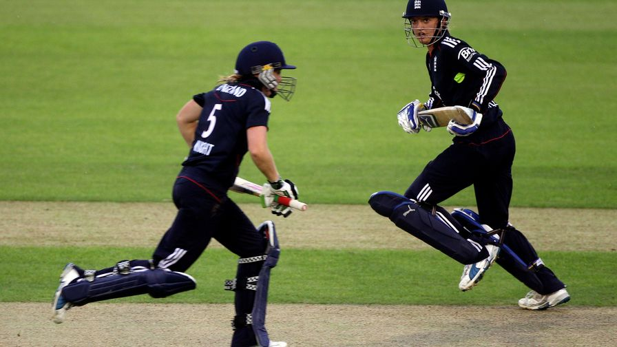 An increasingly familiar sight. Sarah Taylor and Heather Knight lead England to a series win over New Zealand.