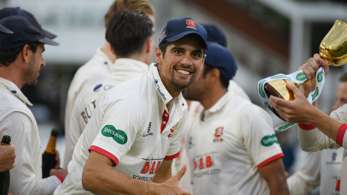 Sir Alastair Cook celebrates with teammates as Essex with the 2019 Specsavers County Championship