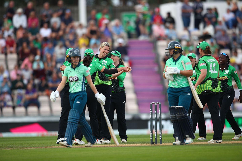 Lauren Bell celebrates one of her three wickets